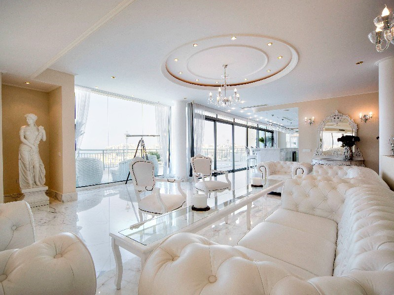 Lavish living room of Portomaso penthouse, enjoying stunning sea views.