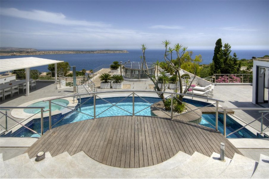 A luxurious fully-detached villa enjoying open sea views of the Mediterranean situated in Mellieha, Malta.