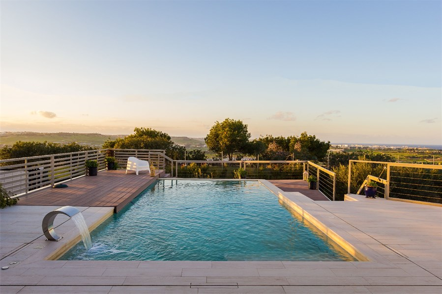 Peaceful pool area overlooking open Maltese countryside and sea views, Naxxar, northern Malta.